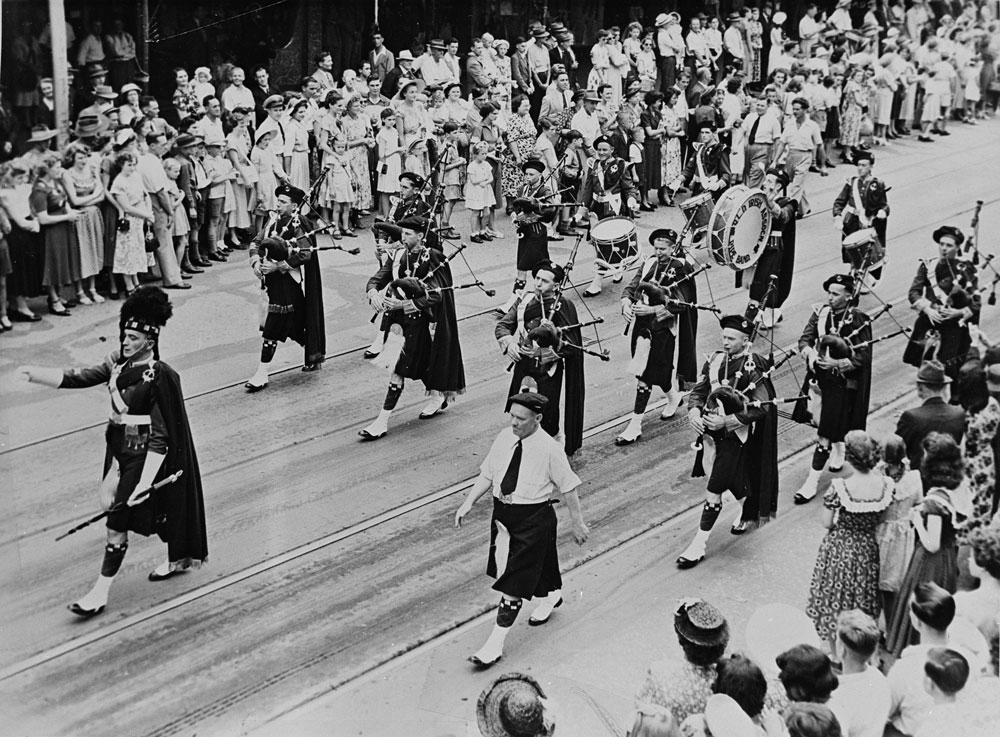 Queensland Irish Association Pipe Band marching in Brisbane Queensland ca. 1950